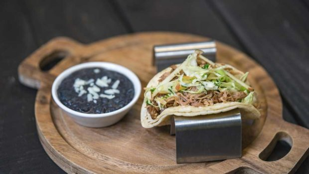 Paradise Garden Grill - Beer-braised Pork Tacos with Pickled Apple Slaw, Black Beans and Queso