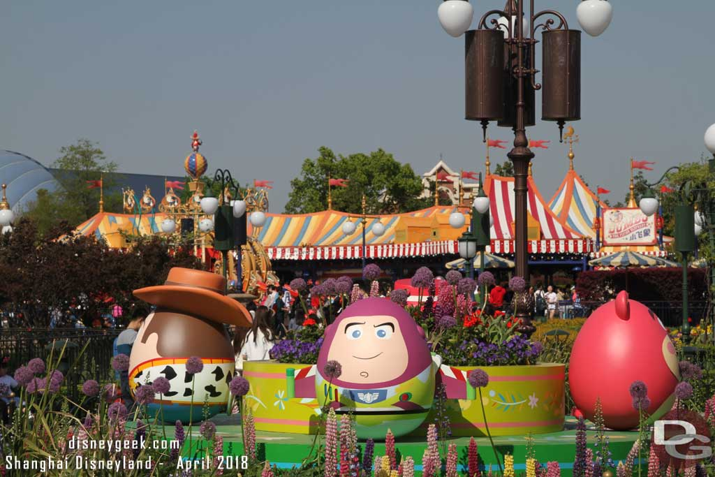 The Toy Story foursome of Woody, Buzz, Jessie and Lotso in the center of the Gardens of Imagination