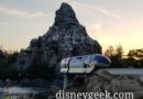 Disneyland Monorail Blue Cruising Over the Sub Lagoon as the Sun Sets