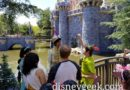 Peter Pan visiting with Aladdin and Jasmine near Sleeping Beauty Castle