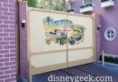 The Backstage Gate near the fire house mural repainting appears finished