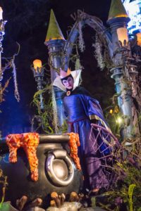 "The guest-favorite ""Frightfully Fun Parade"" delights guests at Disney California Adventure Park during the all-new separate-ticket Oogie Boogie Bash – A Disney Halloween Party on 20 select nights from Sept. 17-Oct. 31, 2019. The Headless Horseman of Sleepy Hollow heralds the arrival of Mickey Mouse and Minnie Mouse who lead the cavalcade of characters, including many mischievous Disney villains. New this year, the ever-curious and whimsical Cheshire Cat from ""Alice in Wonderland"" joins the parade, mischievously smiling at all the magical mayhem. (Disneyland Resort)"