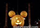 Main Street USA Pumpkin flanked by two light trusses