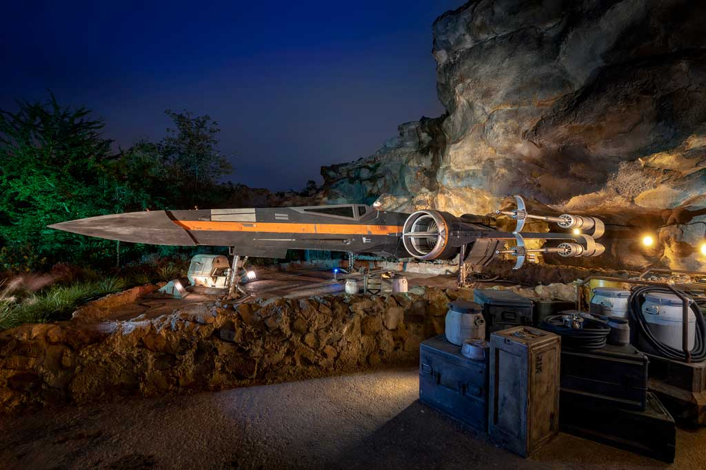 Poe Dameron's X-wing starfighter, Black One, appears in Star Wars: Rise of the Resistance, opening Dec. 5, 2019, at Disney's Hollywood Studios in Florida and Jan. 17, 2020, at Disneyland Park in California. Poe escorts guests off Batuu as they attempt to rendezvous with General Leia Organa in this groundbreaking new attraction inside Star Wars: Galaxy's Edge. (Kent Phillips, photographer)