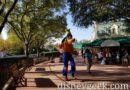Goofy skipping by at Epcot International Gateway
