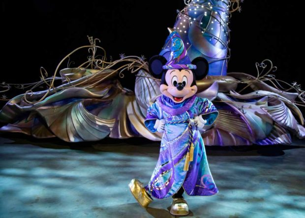 "Pictured during a backstage rehearsal of the ""Magic Happens"" parade set to debut at Disneyland Park in California Feb. 28, 2020, Mickey Mouse will wear an all-new sorcerer-inspired costume as he leads the way from atop a 15-foot tall iridescent magical hat. The parade will come to life with an energetic musical score and new songs and will feature stunning floats, beautiful costumes and beloved Disney characters. (Joshua Sudock/Disneyland Resort)"