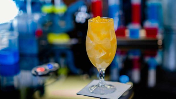 The Regulator, features Patron Silver tequila, lime juice, habanero and mango syrup, Golden Road Mango Cart wheat ale and garnished with mango flavored popping pearls. (David Nguyen/Disneyland Resort)
