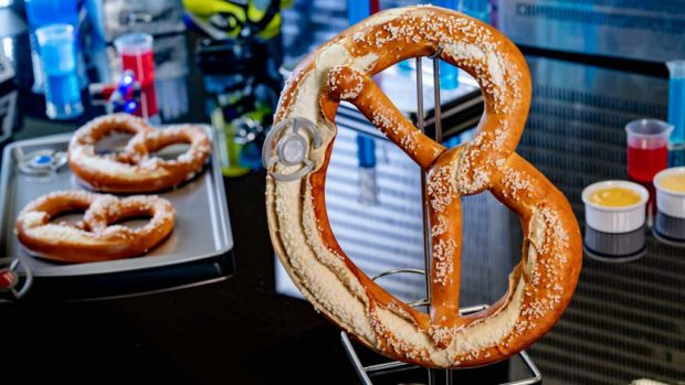 Experiment No. IP42: Quantum Pretzel features a pretzel that has been enlarged by a quantum tunnel and comes with mustard and beer cheese dipping sauce. (David Nguyen/Disneyland Resort)