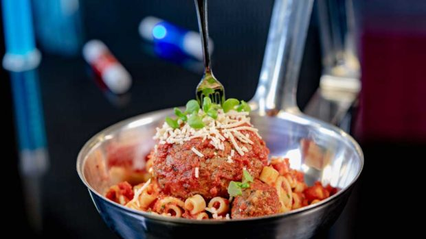 Experiment No. EE45: ImpossibleTM Spoonful, a pasta dish featuring plant-based Impossible™ large and micro meat-balls, served in a super-sized spoon with a tiny fork. (David Nguyen/Disneyland Resort)
