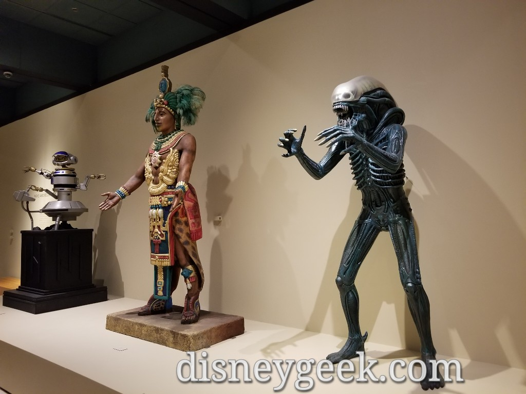 An Alien from the Great Movie Ride and a figure from El Río del Tiempo (The River of Time - boat ride in Mexico at Epcot) plus Rex.