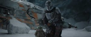 The Mandalorian (Pedro Pascal) and the Child in THE MANDALORIAN, season two. © 2020 Lucasfilm Ltd. & TM. All Rights Reserved.
