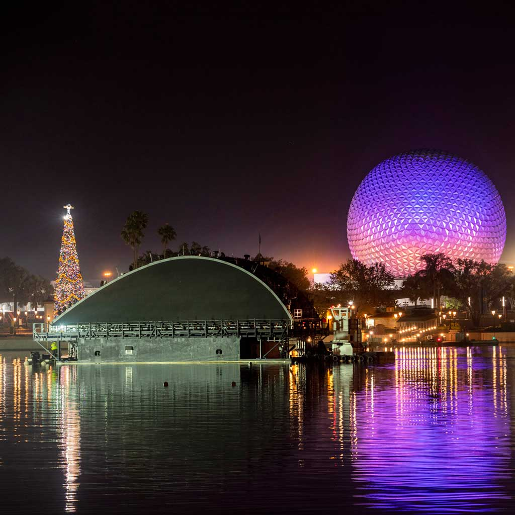 "The first of five floating platforms to be part of ""Harmonious,"" the new nighttime spectacular coming to EPCOT, moves into position to begin testing of its onboard show equipment on the theme park's World Showcase Lagoon, Dec. 11, 2020, at Walt Disney World Resort in Lake Buena Vista, Fla. Once completed, these platforms will create a sparkling fountain, providing new energy to World Showcase during the daytime; after dark, they'll become part of one of the largest nighttime shows ever created for a Disney park. (Kent Phillips, photographer)"