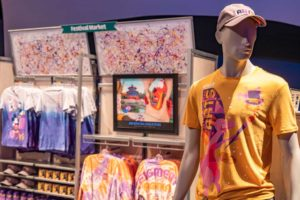 The Taste of EPCOT International Festival of the Arts at Walt Disney World Resort in Lake Buena Vista, Fla., features event-specific merchandise available throughout the park, including shirts, caps, face coverings, trading pins, MagicBands, homeware and more. (Matt Stroshane, photographer)