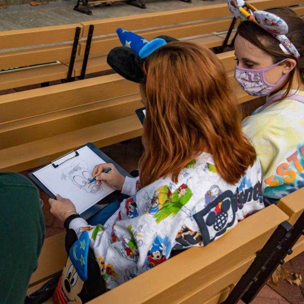 The Taste of EPCOT International Festival of the Arts at Walt Disney World Resort in Lake Buena Vista, Fla., offers the Animation Academy at America Gardens Theatre, where a Disney artist gives guests a step-by-step lesson in drawing Disney characters. (Matt Stroshane, photography)