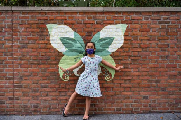 The Taste of EPCOT International Festival of the Arts at Walt Disney World Resort in Lake Buena Vista, Fla., invites guests to step in front of wings on walls throughout the park for a fun photo opportunity. (Matt Stroshane, photographer)
