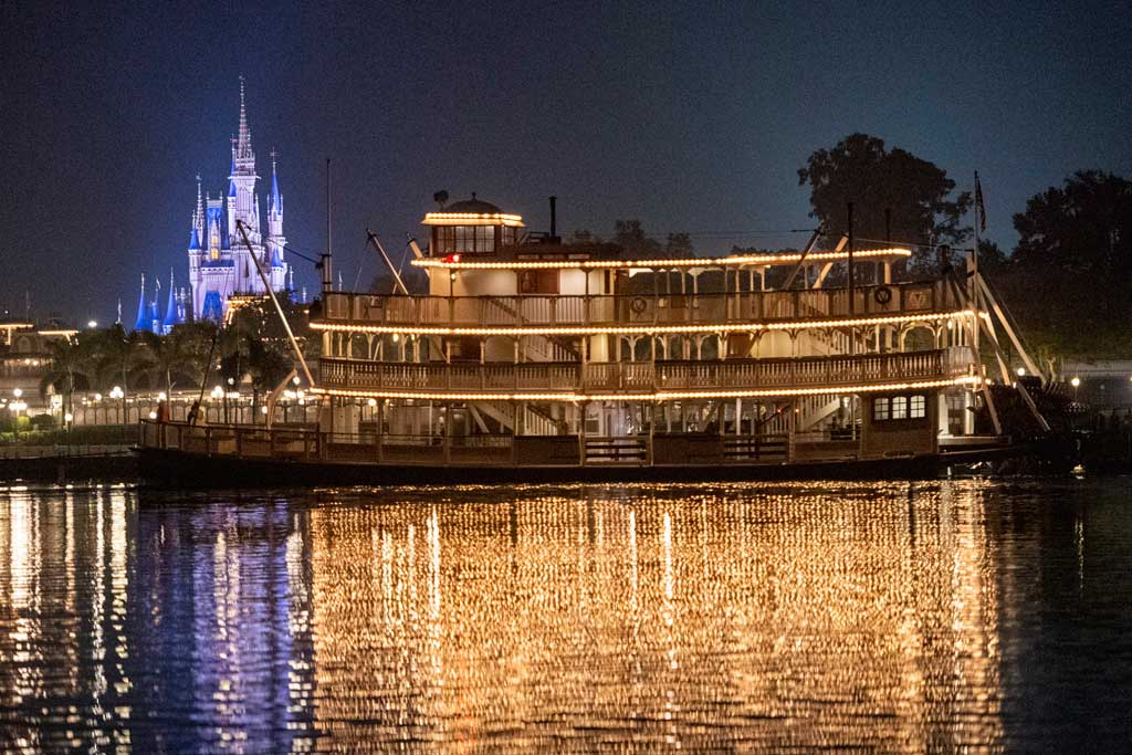 The Liberty Belle riverboat crosses in front of Magic Kingdom Park during an overnight repositioning following a nearly complete scheduled refurbishment at Walt Disney World Resort in Lake Buena Vista, Fla. It was a rare sight to behold, as crews towed the 47-foot-tall classic steam ship back to her home in Liberty Square. (David Roark, photographer)