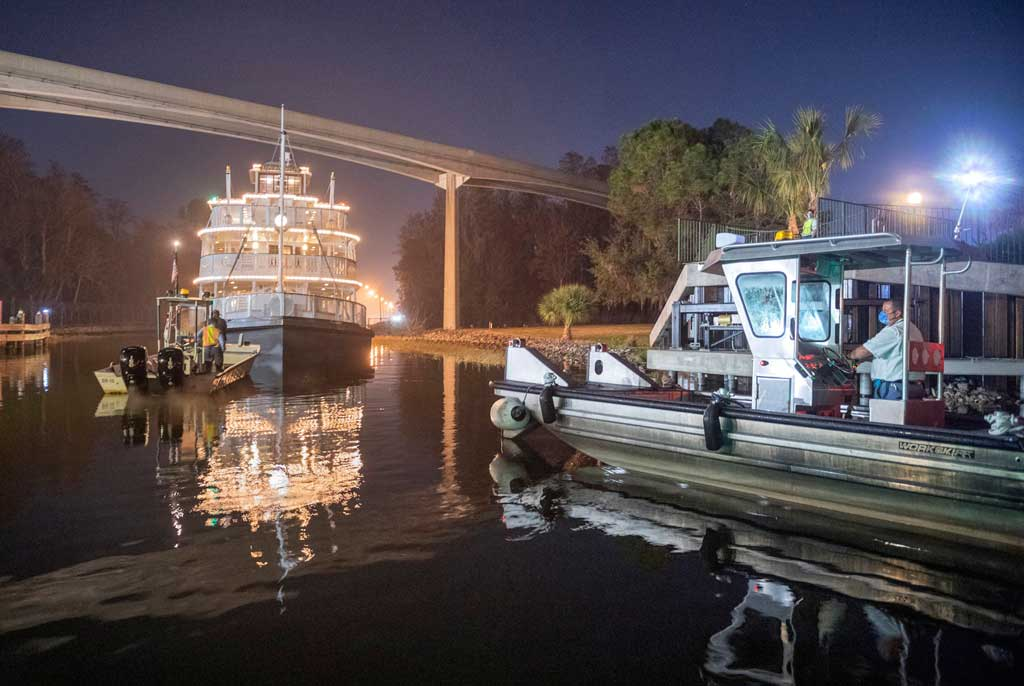 Cast members oversee repositioning the Liberty Belle riverboat following a nearly complete scheduled refurbishment of Rivers of America inside Magic Kingdom Park at Walt Disney World Resort in Lake Buena Vista, Fla. The authentic paddle wheeler was returned to the park from a temporary dry dock. (Kent Phillips, photographer)