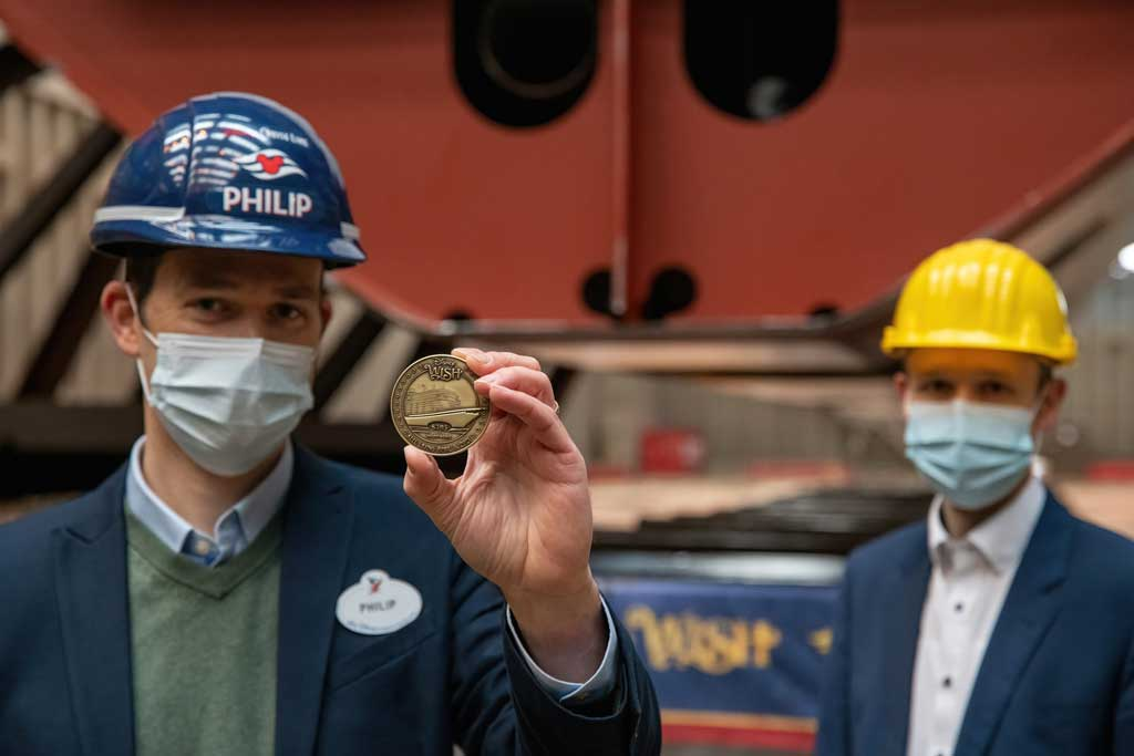 Philip Gennotte, portfolio project management executive, Walt Disney Imagineering Germany and Jan Meyer, chief executive office of Meyer Werft celebrated the keel laying ceremony for the Disney Wish in Papenburg, Germany. (Robert Fiebak, photographer)