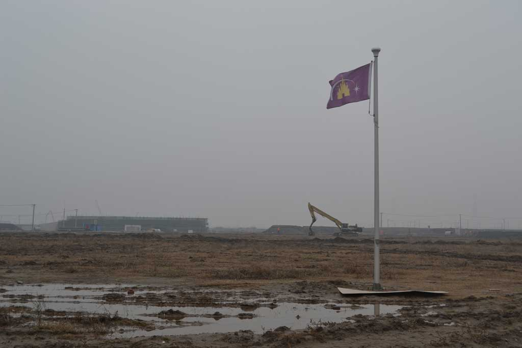 A flag standing on the construction site, indicating where the world's tallest and largest Disney Castle – Enchanted Storybook Castle – would eventually stand. The