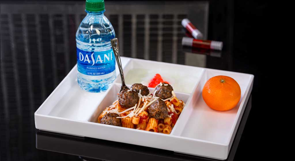 Mini Pasta & Impossible Meat-balls dish is crafted with rigatoni and ditalini pastas, plant-based meat-balls, tomato sauce and dairy-free Parmesan served with coconut milk yogurt and small DASANI water. (David Nguyen/Disneyland Resort)