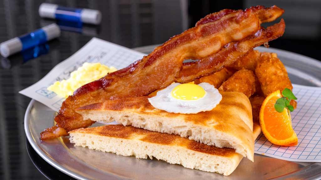 Calculated Breakfast = E x 2 + (B+P)/T Ð Eggs Two Ways with smoked bacon, crispy potato bites, and focaccia toast (David Nguyen/Disneyland Resort)