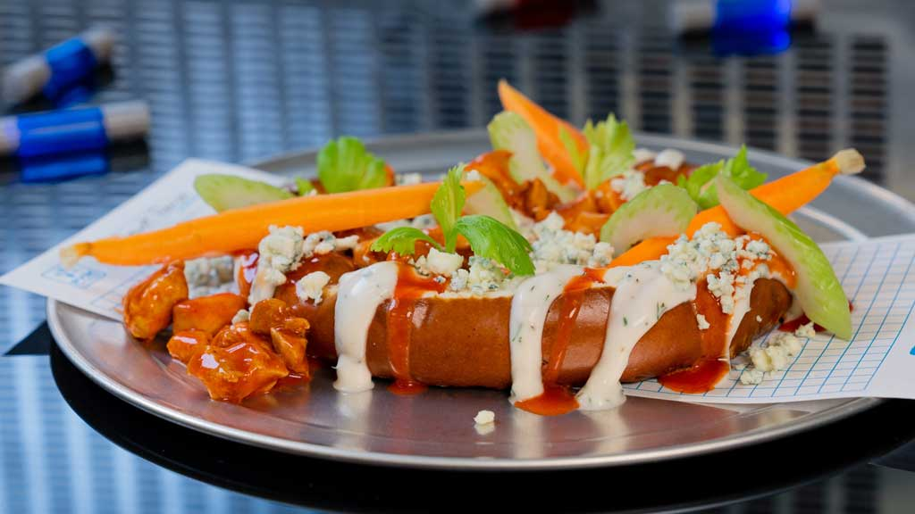 Atomic Fusion Pretzel, a Buffalo-style pretzel loaded with chicken, hot sauce, ranch dressing, blue cheese crumbles, celery, and dill-pickled carrots (David Nguyen/Disneyland Resort)