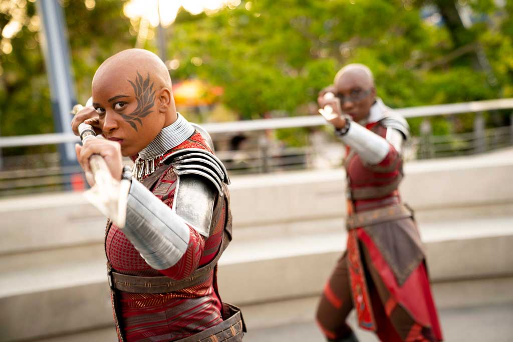 Recruits at Avengers Campus at Disney California Adventure Park are invited to join Black Panther's loyal bodyguards, the Dora Milaje, in training sessions in the courtyard near Avengers Headquarters. Here, they may learn wisdom from Wakanda and participate in a series of strength and skill exercises. Okoye, the leader of the Dora Milaje, debuts for the first time in a Disney park at Avengers Campus, as she leads this training encounter. (Ty Popko/Disneyland Resort)
