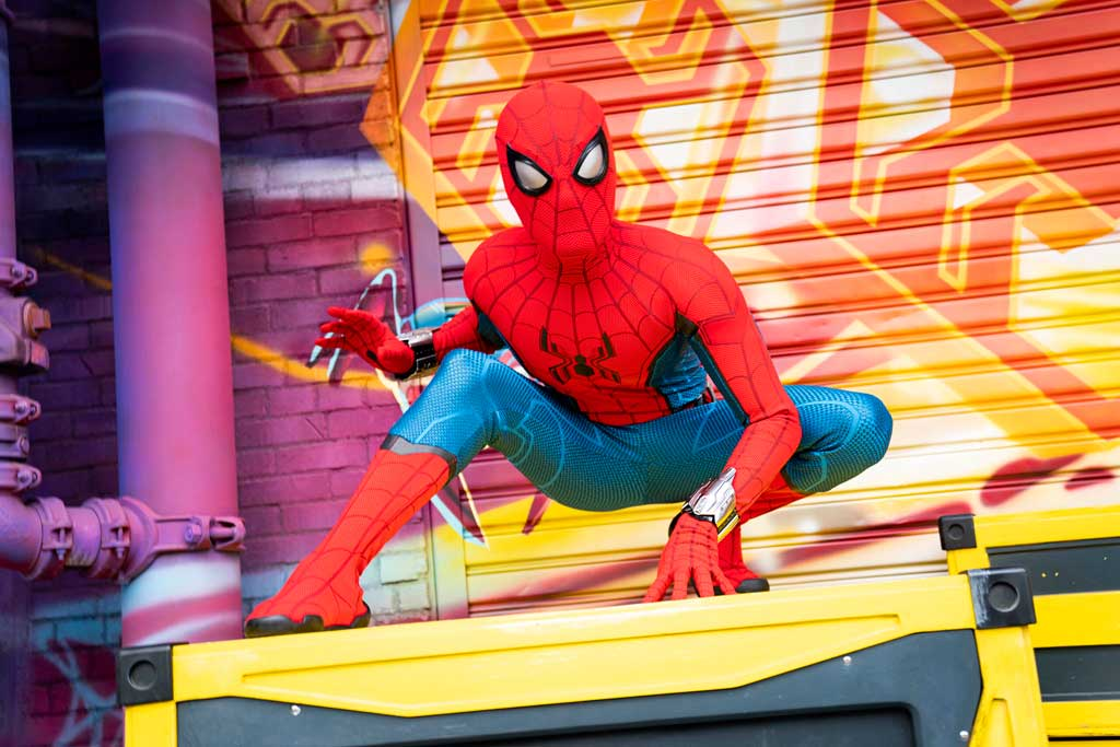 """Throughout the day at Avengers Campus at Disney California Adventure Park, recruits have the chance to witness Spider-Man swing into action high above Avengers Campus with gravity-defying, acrobatic feats never before seen in a Disney park. Spider-Man flips 60 to 65 feet in the air above the rooftop of the WEB building. Following those stunning moves, Spider-Man swings down off the building to ground level to say hello and inspire the """"new recruits"""" he meets on campus. (Ty Popko/Disneyland Resort)"""