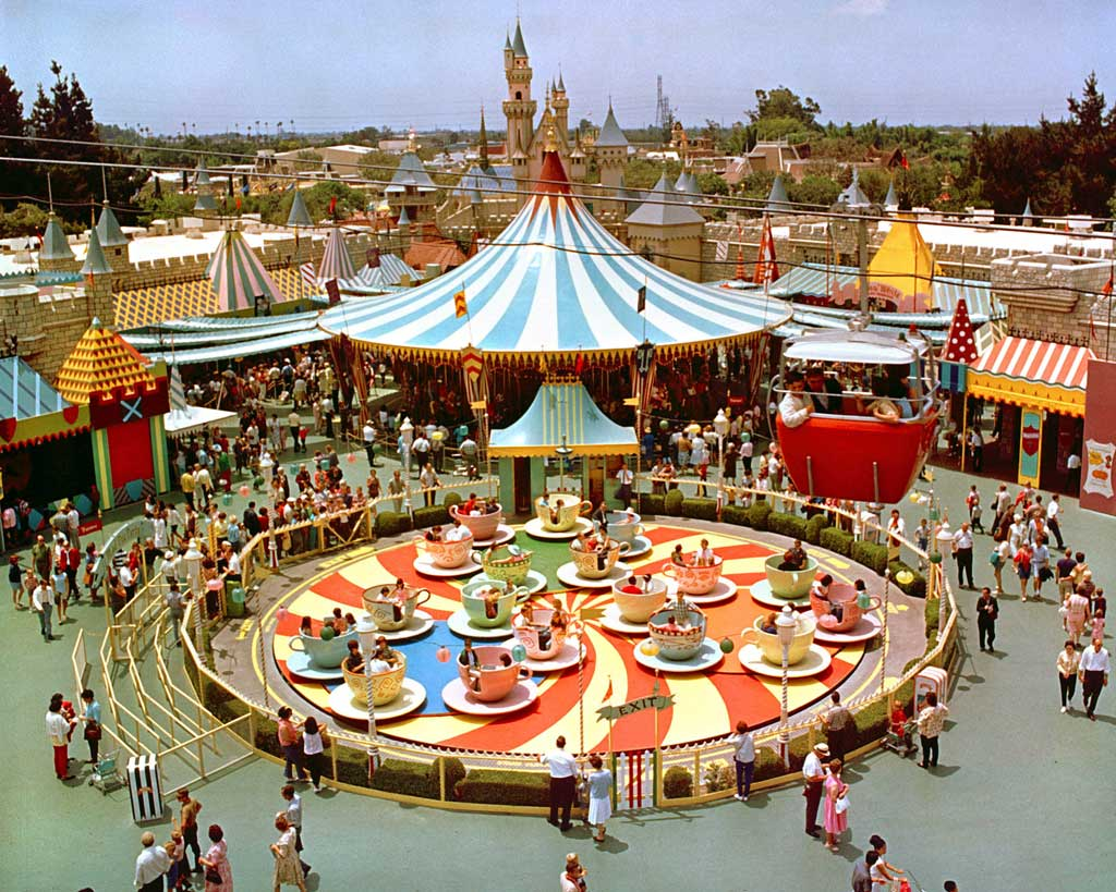 """MAD TEA PARTY (1966) -- This opening day attraction, based on a scene in """"Alice in Wonderland,"""" spins Disneyland guests in giant teacups. Pictured here at its original location, it was moved near the Matterhorn in 1983 during the construction of the new Fantasyland."""