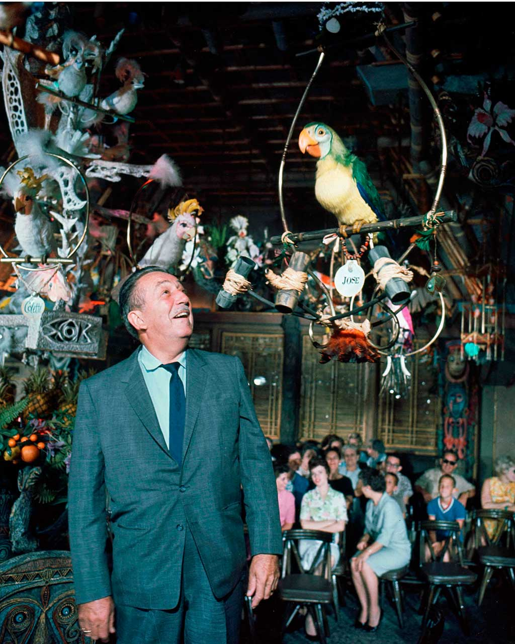 WALT DISNEY AT THE ENCHANTED TIKI ROOM (1963) -– The first attraction to feature sophisticated Audio-Animatronics figures opened June 23, 1963. The show features more than 200 birds, tikis and flowers. (Disneyland Resort)
