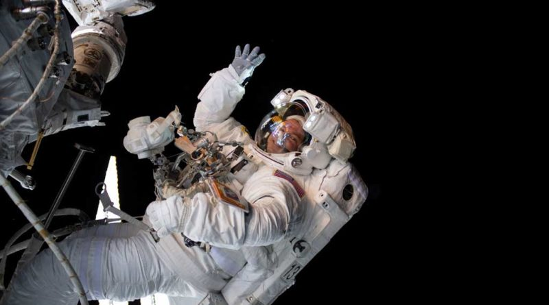 AMONG THE STARS - (Aug. 21, 2019) - NASA astronaut Andrew Morgan waves as he is photographed during a spacewalk to install the International Space Station's second commercial crew vehicle docking port, the International Docking Adapter-3 (IDA-3).