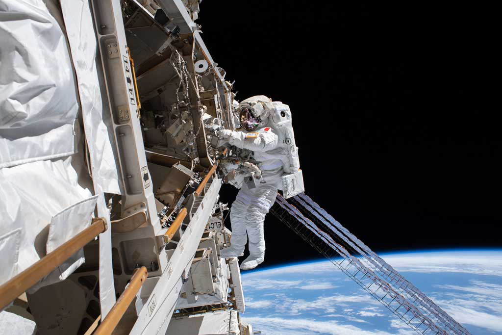 AMONG THE STARS - (Jan. 25, 2020) - ESA (European Space Agency) astronaut Luca Parmitano is pictured tethered to the International Space Station while finalizing thermal repairs on the Alpha Magnetic Spectrometer, a dark matter and antimatter detector, during a spacewalk that lasted 6 hours and 16 minutes. (NASA)