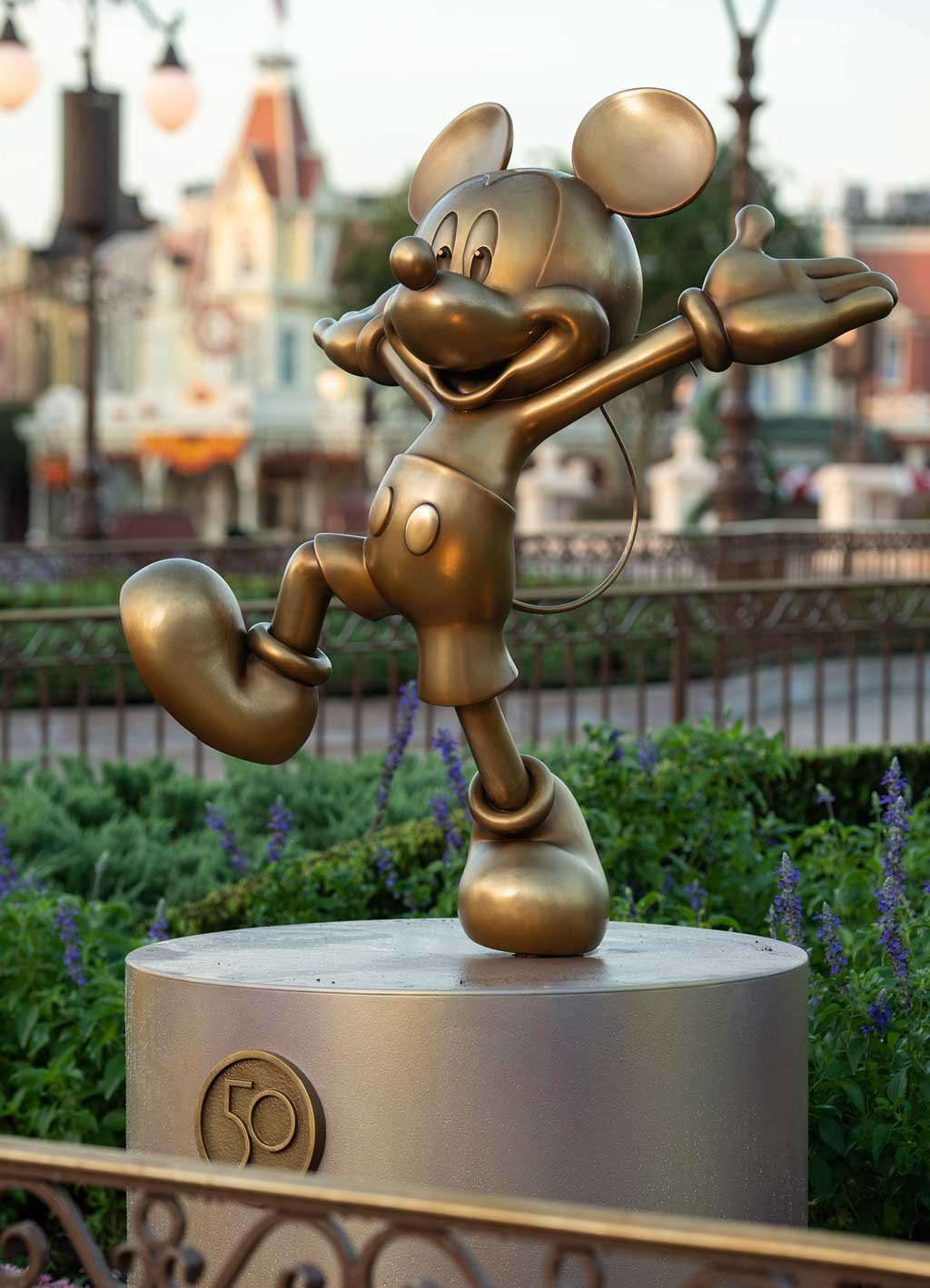 """Mickey Mouse is one of the """"Disney Fab 50"""" golden character sculptures appearing in all four Walt Disney World Resort theme parks in Lake Buena Vista, Fla., as part of """"The World's Most Magical Celebration,"""" beginning Oct. 1, 2021, in honor of the resort's 50th anniversary. (David Roark, photographer)"""