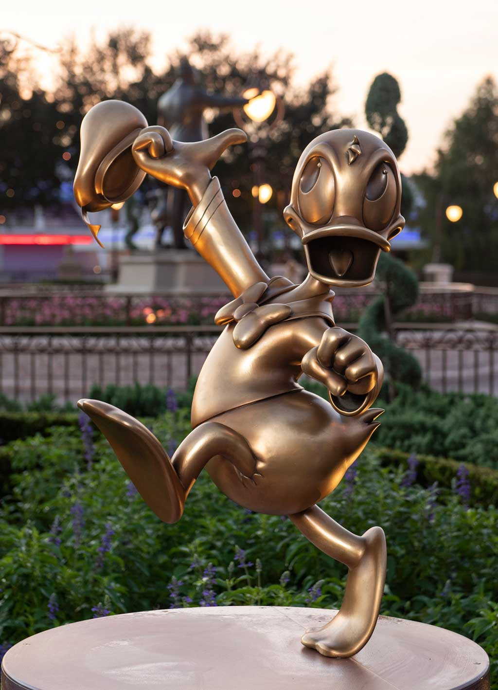 """Donald Duck at Magic Kingdom Park is one of the """"Disney Fab 50"""" golden character sculptures appearing in all four Walt Disney World Resort theme parks in Lake Buena Vista, Fla., as part of """"The World's Most Magical Celebration,"""" beginning Oct. 1, 2021, in honor of the resort's 50th anniversary. (David Roark, photographer)"""