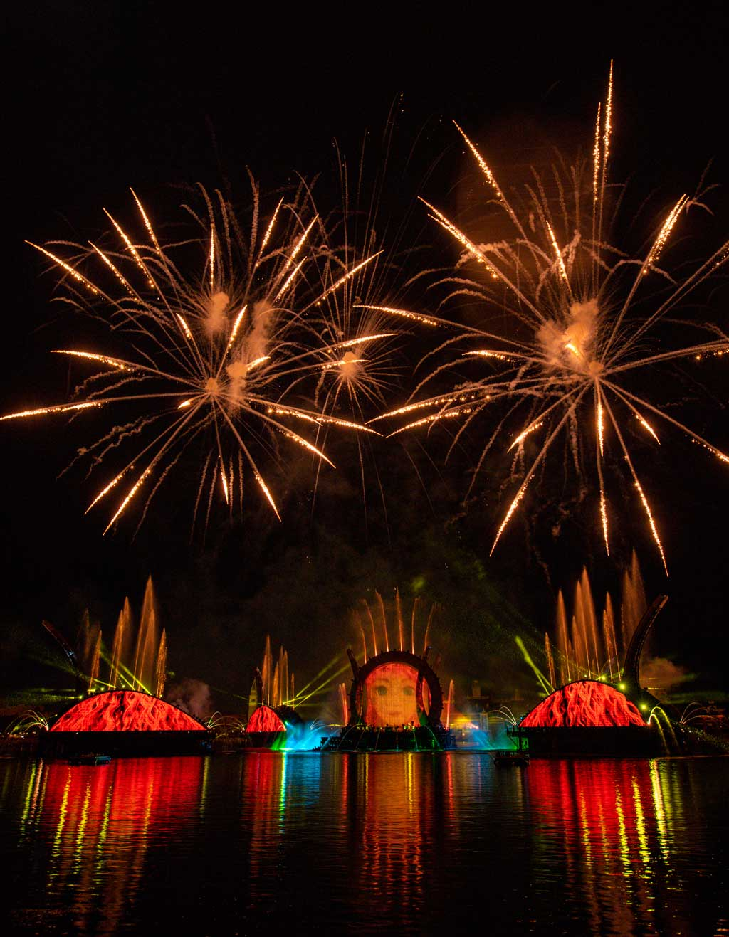 """""""Harmonious"""" at EPCOT is one of the largest nighttime spectaculars ever created for a Disney theme park. Debuting Oct. 1, 2021, at Walt Disney World Resort in Lake Buena Vista, Fla., the show celebrates the way Disney music inspires people the world over, carrying them away on a stream of familiar songs reinterpreted by a culturally diverse group of 240 artists from around the globe. """"Harmonious"""" features massive floating set pieces, custom-built LED panels, choreographed moving fountains, lights, pyrotechnics, lasers and more. (David Roark, photographer)"""