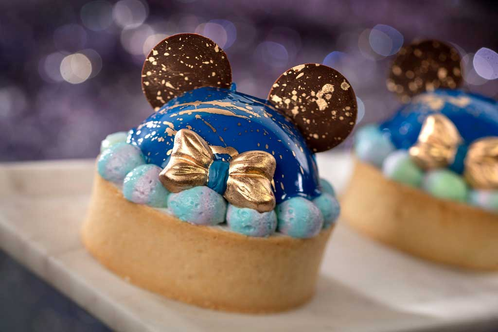 The special food and beverage offerings for the 50th Anniversary of Walt Disney World are full of whimsy and EARidescent shimmer, like the 50th Celebration Tart available at The Market at Ale & Compass at Disney's Yacht & Beach Club Resorts at Walt Disney World Resort in Lake Buena Vista, Fla. (Kent Phillips, photographer).
