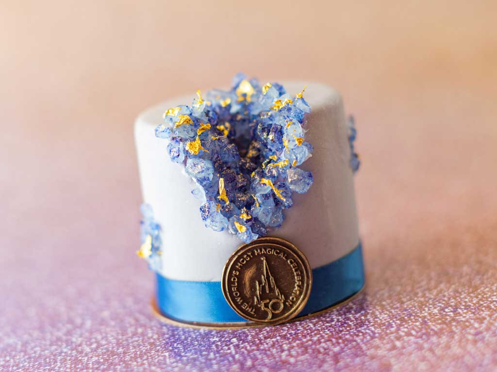 The special food and beverage offerings for the 50th Anniversary of Walt Disney World are full of whimsy and EARidescent shimmer, like the 50th Celebration Petit Cake available at Amorette's Patisserie at Disney Springs at Walt Disney World Resort in Lake Buena Vista, Fla. (Kent Phillips, photographer).